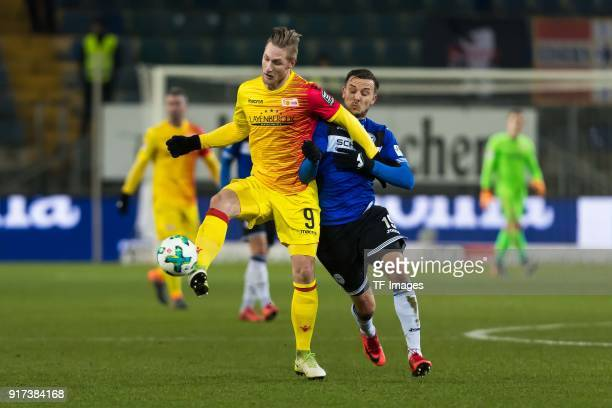 Sebastian Polter of Berlin and Manuel Prietl of Bielefeld battle for the ball during the Second Bundesliga match between Arminia Bielefeld and Union...