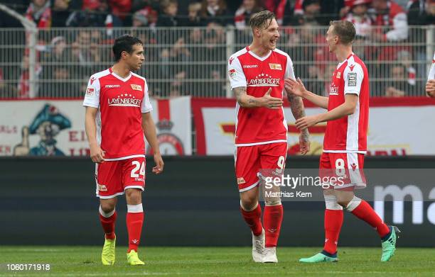 Sebastian Polter of Berlin celebrates with teammate Joshua Mees after scoring his team's third goal during the Second Bundesliga match between 1 FC...