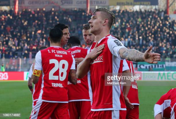 Sebastian Polter of Berlin celebrates with teammates after scoring his team's fourth goal during the Second Bundesliga match between 1 FC Union...