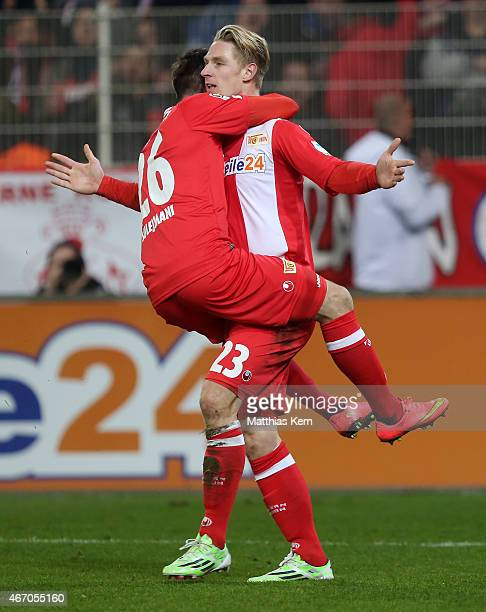 Sebastian Polter of Berlin jubilates with team mate Valmir Sulejmani after scoring the first goal during the Second Bundesliga match between 1.FC...