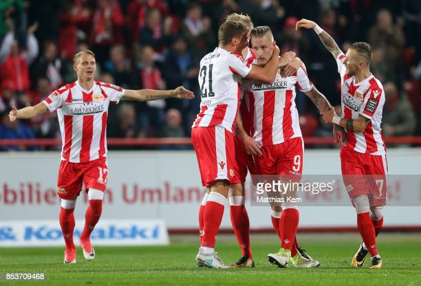 Sebastian Polter of Berlin jubilates with team mates after scoring the first goal during the Second Bundesliga match between 1 FC Union Berlin and 1...