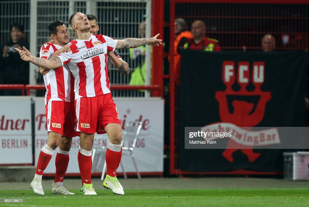 Sebastian Polter (C) of Berlin jubilates with team mates after scoring the third goal during the Second Bundesliga match between 1. FC Union Berlin and 1. FC Kaiserslautern at Stadion An der Alten Foersterei on September 25, 2017 in Berlin, Germany.