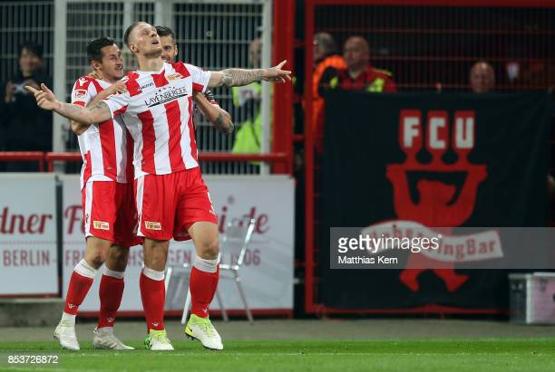Sebastian Polter of Berlin jubilates with team mates after scoring the third goal during the Second Bundesliga match between 1 FC Union Berlin and 1...