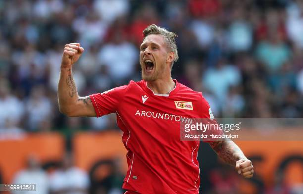Sebastian Polter of FC Union Berlin celebrates his sides first goal during the Bundesliga match between FC Augsburg and 1 FC Union Berlin at WWKArena...
