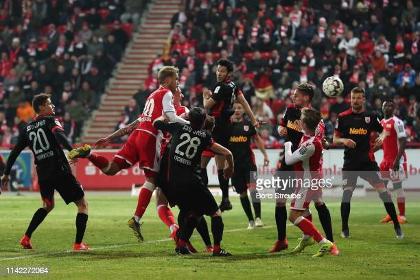 Sebastian Polter of FC Union Berlin scores his team's second goal past his team mate Sebastian Andersson during the Second Bundesliga match between...