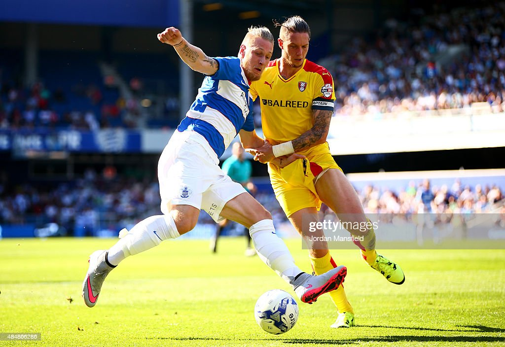 Sebastian Polter of QPR challenges for a ball with Greg Halford of Rotherham during the Sky Bet Championship match between Queens Park Rangers and Rotherham United at Loftus Road on August 22, 2015 in London, England.