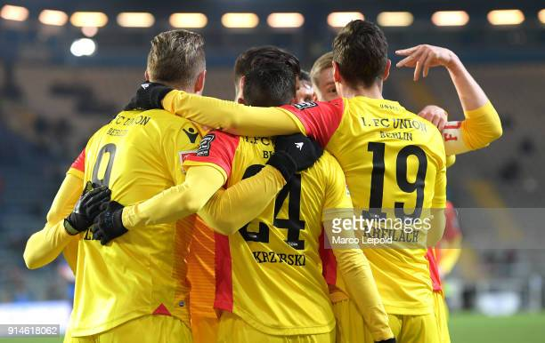 Sebastian Polter Steven Skrzybski and Damir Kreilach of 1 FC Union Berlin celebrate the 01 during the Second Bundesliga match between DSC Arminia...