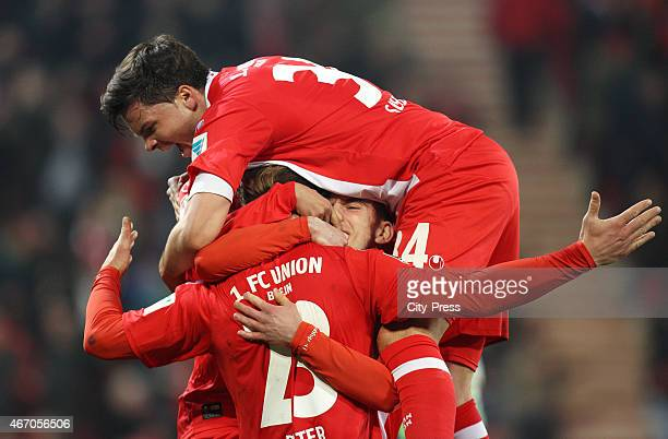 Sebastian Polter, Valmir Sulejmani and Fabian Schoenheim of 1 FC Union Berlin celebrate after scoring the 1:0 during the match between Union Berlin...