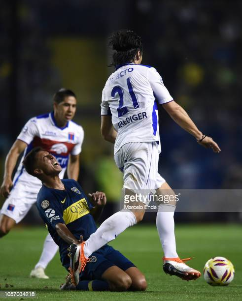 Sebastian Prediger of Tigre fights for the ball with Agustin Almendra of Boca Juniors during a match between Boca Juniors and Tigre as part of...