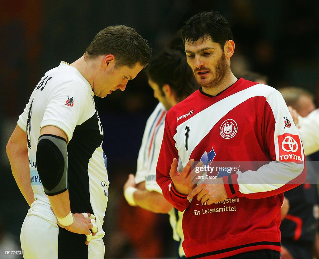 Sebastian Preiss and goalkeeper Henning Fritz are looking dejected after loosing the Men's Handball European Championship main round Group II match between Germany and France at Trondheim Spektrum on January 23, 2008 in Trondheim, Norway.