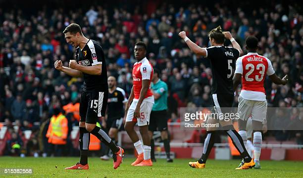 Sebastian Prodl and Craig Cathcart of Watford celebrate victory after the Emirates FA Cup sixth round match between Arsenal and Watford at Emirates...