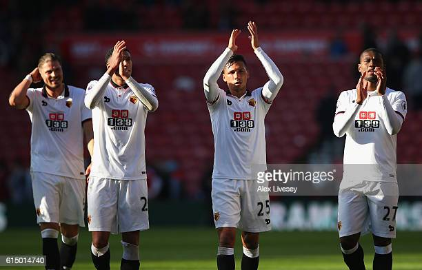 Sebastian Prodl Etienne Capoue Jose Holebas and Christian Kabasele of Watford celebrate victory with their supporters following the Premier League...