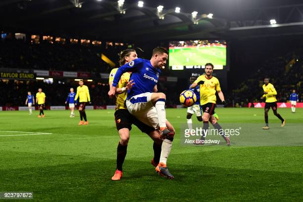 Sebastian Prodl of Watford and Gylfi Sigurdsson of Everton battle for the ball during the Premier League match between Watford and Everton at...