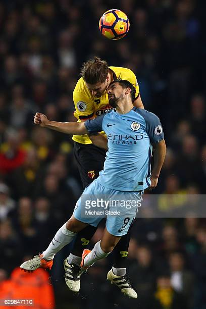 Sebastian Prodl of Watford and Nolito of Manchester City battle to win a header during the Premier League match between Manchester City and Watford...