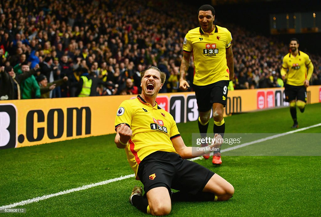 Sebastian Prodl of Watford (front) celebrates with Troy Deeney as he scores their second goal during the Premier League match between Watford and Everton at Vicarage Road on December 10, 2016 in Watford, England.