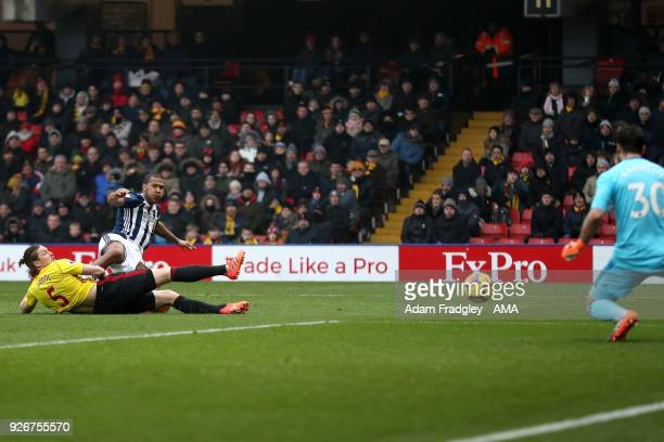 Sebastian Prodl of Watford challenges Salomon Rondon of West Bromwich Albion as he shoots at goal before Orestis Karnezis of Watford gathers his shot...