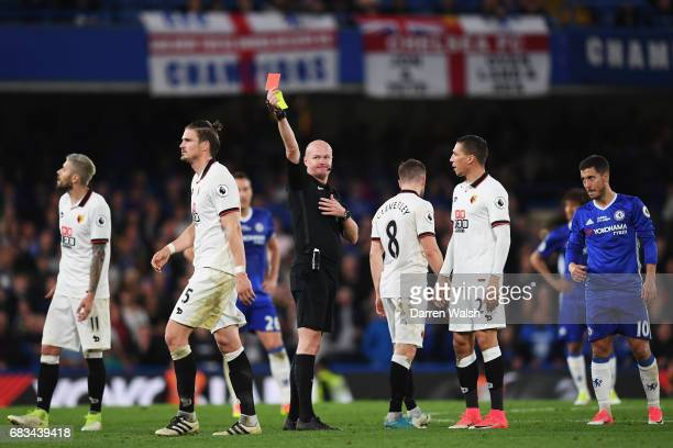 Sebastian Prodl of Watford is shown a red card by referee Lee Mason after picking up his second yellow of the game during the Premier League match...