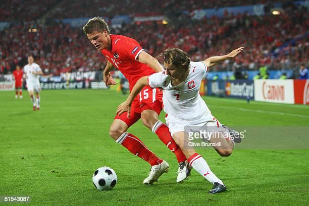 Sebastian Proedl of Austria and Euzebiusz Smolarek of Poland battle for the ball during the UEFA EURO 2008 Group B match between Austria and Poland...