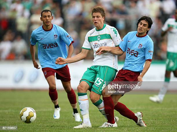 Sebastian Proedl of Bremen and Hrvoif Cale of Trabzonspor compete for the ball during the friendly match between Werder Bremen and Trabzonspor at the...