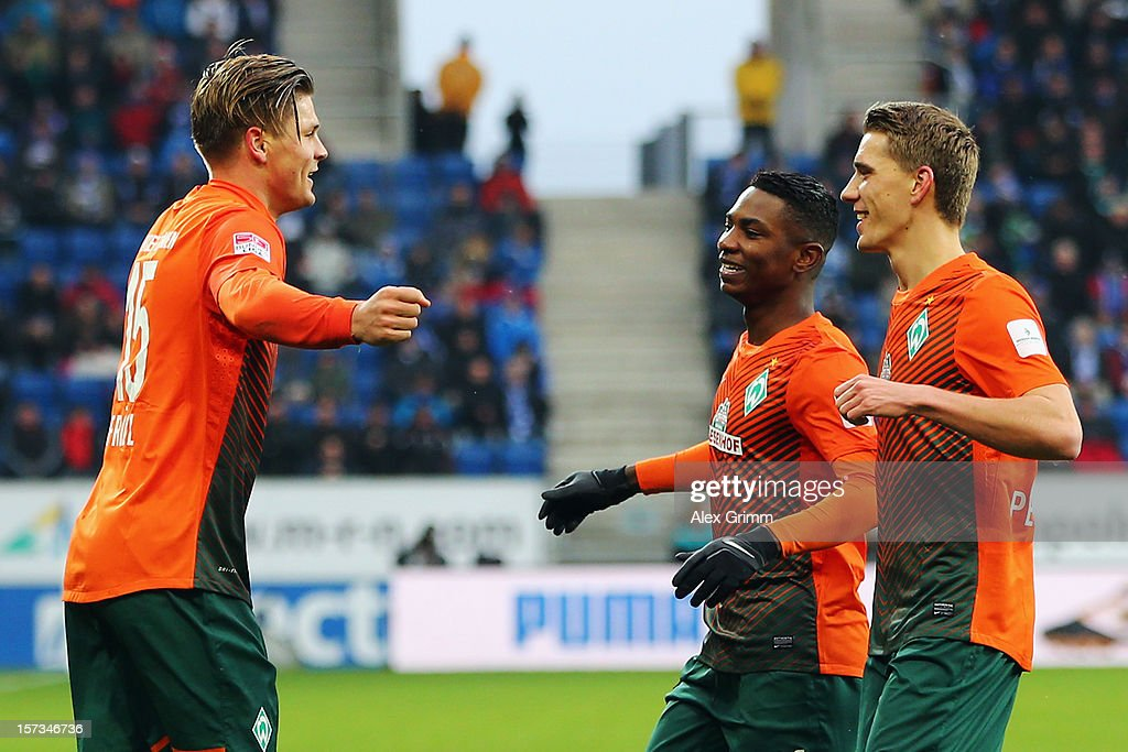 Sebastian Proedl of Bremen celebrates his team's first goal with team mates Eljero Elia and Nils Petersen (L-R) during the Bundesliga match between TSG 1899 Hoffenheim and SV Werder Bremen at Rhein-Neckar-Arena on December 2, 2012 in Sinsheim, Germany.