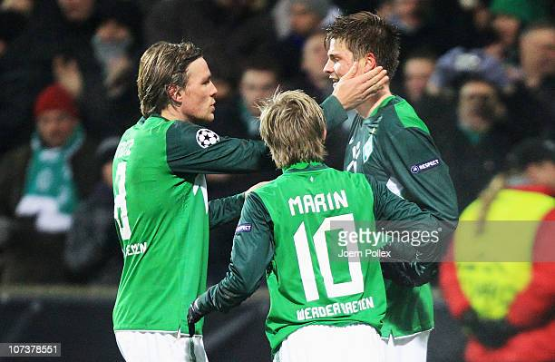 Sebastian Proedl of Bremen celebrates with his team mates Clemens Fritz and Marko Marin after scoring his team's first goal during the UEFA Champions...