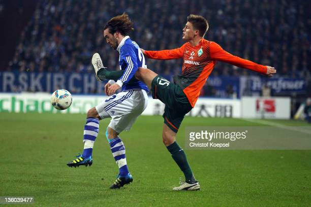 Sebastian Proedl of Bremen challenges Christian Fuchs of Schalke during the Bundesliga match between FC Schalke 04 and SV Werder Bremen at Veltins...