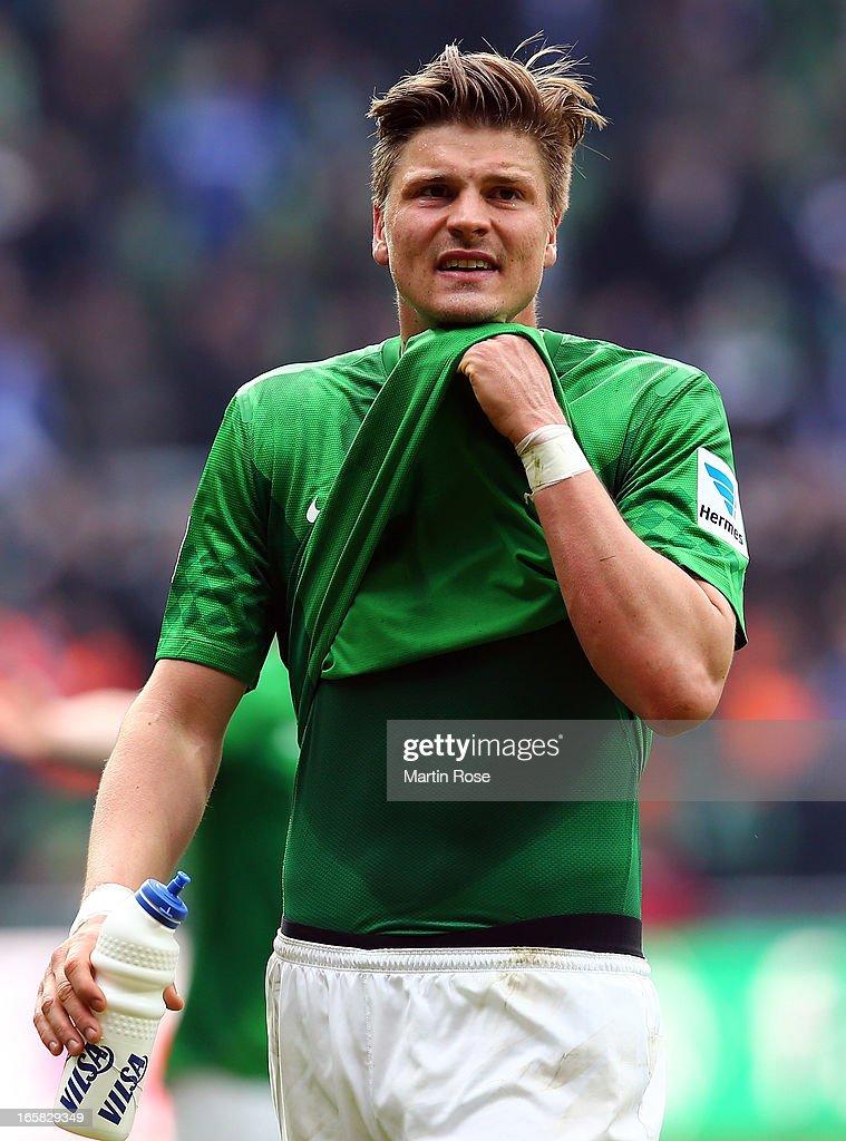 Sebastian Proedl of Bremen looks dejected after the Bundesliga match between Werder Bremen and FC Schalke 04 at Weser Stadium on April 6, 2013 in Bremen, Germany.