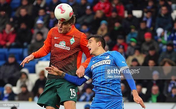 Sebastian Proedl of Bremen scores his team's first goal against Joselu of Hoffenheim during the Bundesliga match between TSG 1899 Hoffenheim and SV...