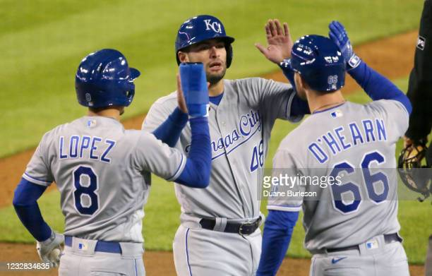 Sebastian Rivero of the Kansas City Royals celebrates with Nicky Lopez and Ryan O'Hearn after they all scored on a double by Jorge Soler to tie the...
