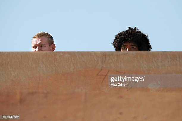 Sebastian Rode and Dante of Bayern Muenchen watch the Schalke training session during day 7 of the FC Schalke 04 training camp at the ASPIRE Academy...