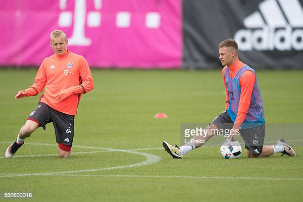Sebastian Rode and Joshua Kimmich of FC Bayern Muenchen stretch during a training session on May 19 2016 in Munich Germany