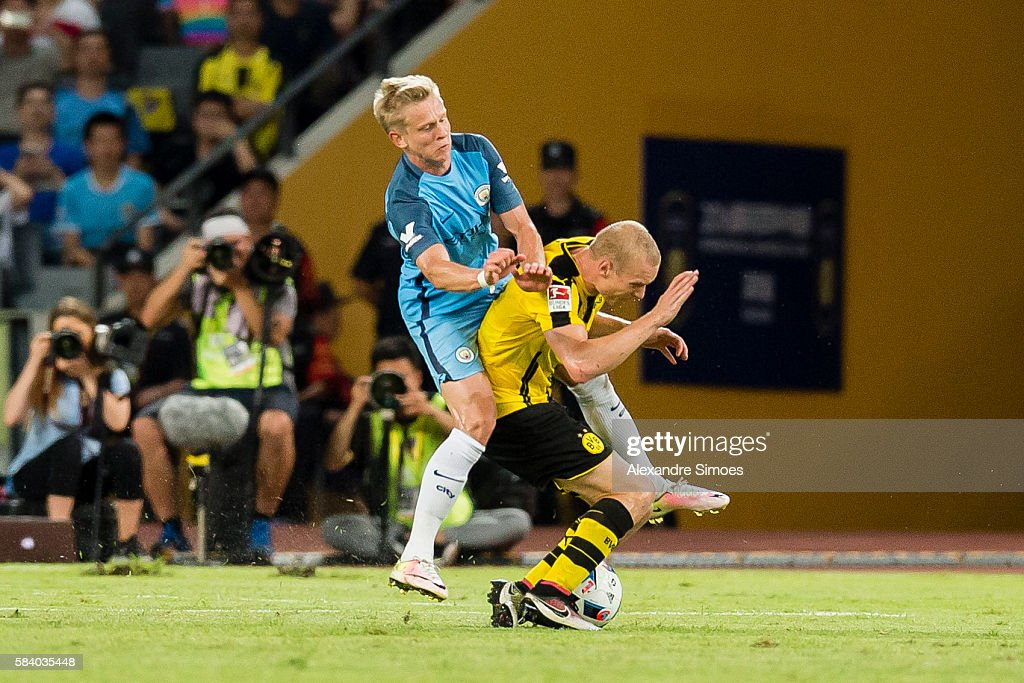 Sebastian Rode of Borussia Dortmund in action againstAlex Zinchenko of Manchester City during the International Champions Cup China match between Manchester City and Borussia Dortmund during Borussia Dortmund's Summer Asia Tour 2016 on July 28 2016 in Shenzhen, China.
