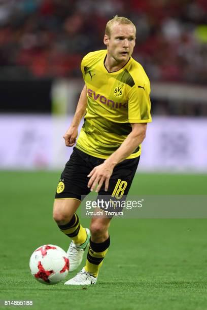Sebastian Rode of Borussia Dortmund runs with the ball during the preseason friendly match between Urawa Red Diamonds and Borussia Dortmund at...