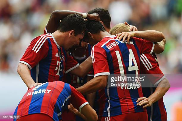 Sebastian Rode of FC Bayern Muenchen celebrates with team mates after scoring his team's second goal during the Telekom Cup 2014 final match between...