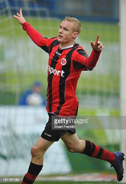 Sebastian Rode of Frankfurt celebrates scoring his team's fourth goal during the second Bundesliga match between Hansa Rostock the DKB Arena...