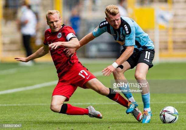 Sebastian Rode of Frankfurt in action against Dominik Martinovic of Waldhof Mannheim during the DFB Cup first round match between Waldhof Mannheim...