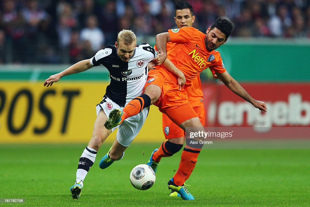Sebastian Rode (L) of Frankfurt is challenged by Mirkan Aydin of Bochumduring the DFB Cup second round match between Eintracht Frankfurt and VfL Bochum at Commerzbank-Arena on September 25, 2013 in Frankfurt am Main, Germany.