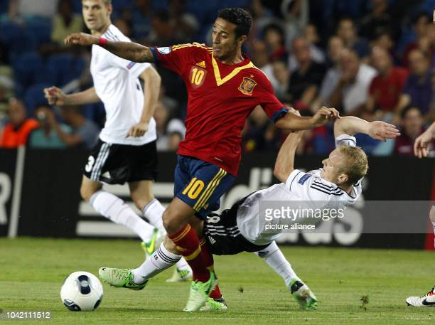 Sebastian Rode of Germany and Thiago Alcantara Spain vie for the ball during the UEFA European Under-21 Championship Group B soccer match between...