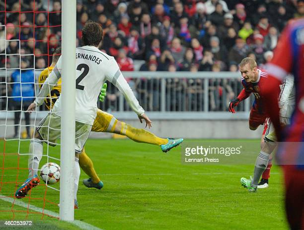 Sebastian Rode of Muenchen scores his team's second goal against Mario Fernandes and Igor Akinfeev of Moscow during the UEFA Champions League Group E...