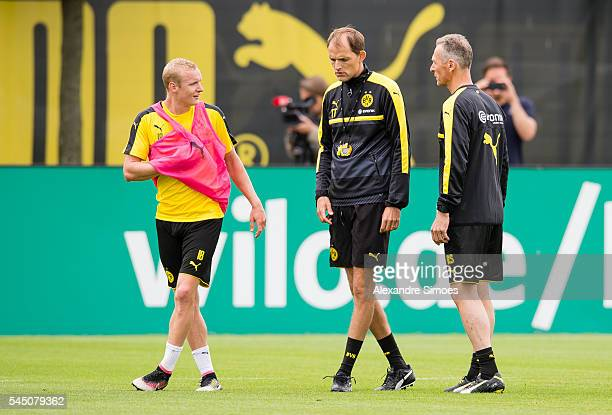 Sebastian Rode with Manager Thomas Tuchel and Rainer Schrey of Borussia Dortmund during the training session on the training ground of Borussia...