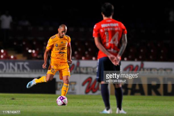 Sebastian Rodriguez of Veracruz watches Guido Rodriguez Tigres, kicking the ball during the Mexican Apertura 2019 tournament football match at Luis...