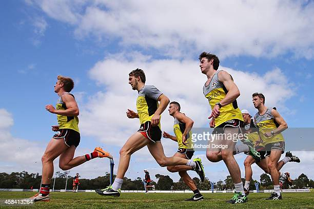 Sebastian Ross leads as players sprint half a lap during a StKilda Saints AFL training session at Linen House Oval on November 5 2014 in Melbourne...
