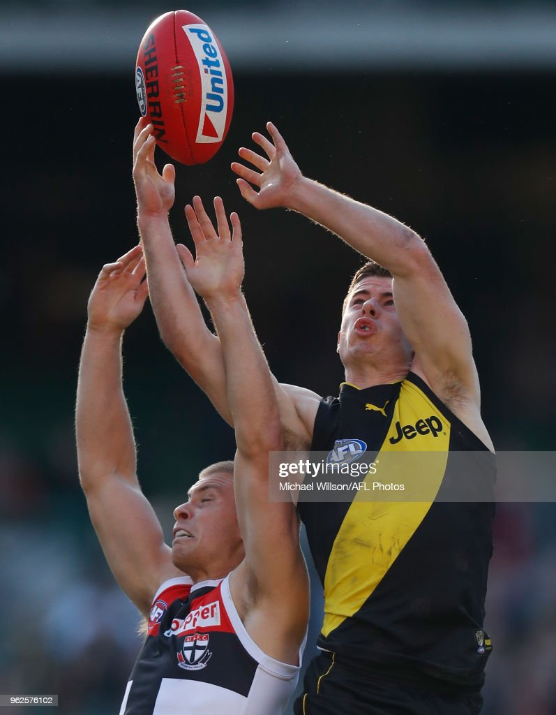Sebastian Ross of the Saints and Jack Higgins of the Tigers compete for the ball during the 2018 AFL round 10 match between the Richmond Tigers and the St Kilda Saints at the Melbourne Cricket Ground on May 26, 2018 in Melbourne, Australia.