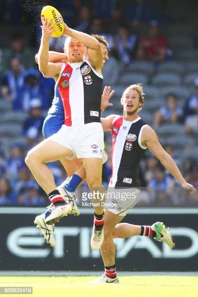 Sebastian Ross of the Saints marks the ball against Ben Jacobs of the Kangaroos during the round two AFL match between the North Melbourne Kangaroos...