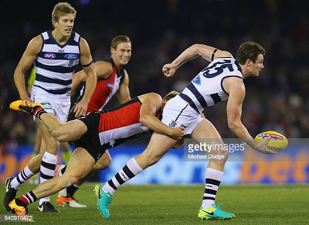 Sebastian Ross of the Saints tackles Patrick Dangerfield of the Cats during the round 14 AFL match between the St Kilda Saints and the Geelong Cats...