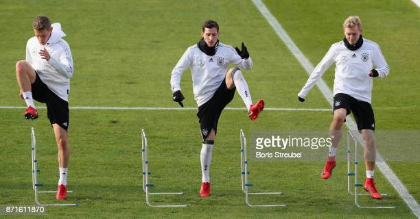 Sebastian Rudy Matthias Ginter and Julian Brandt of Germany pratice during a training session of the German National team at...