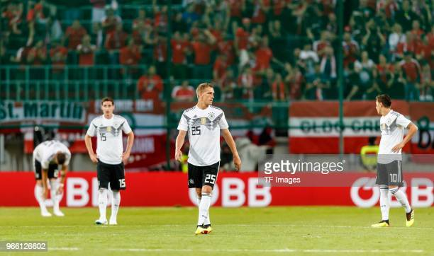 Sebastian Rudy Nils Petersen and Mesut Oezil of Germany looks on during the international friendly match between Austria and Germany at Woerthersee...