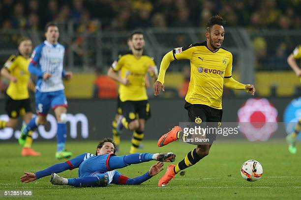 Sebastian Rudy of 1899 Hoffenheim fouls PierreEmerick Aubameyang of Borussia Dortmund leading to his red card during the Bundesliga match between...