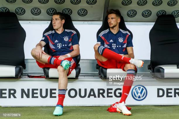 Sebastian Rudy of Bayern Muenchen and Leon Goretzka of Bayern Muenchen sit on the bench prior to the DFL Supercup match between Eintracht Frankfurt...