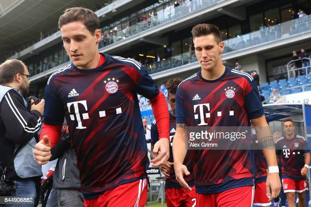 Sebastian Rudy of Bayern Muenchen and Niklas Suele of Bayern Muenchen both former Hoffenheim players enter the stadium for warmup during the...